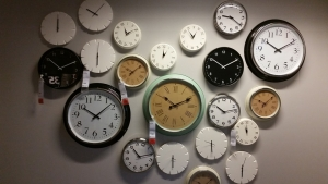 multiple clocks on a wall